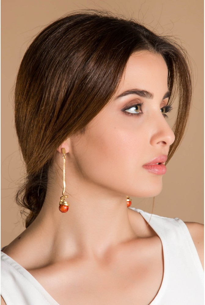 Silver earring  with a coral drop