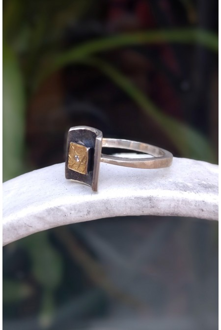 Elegant handmade Sterling Silver ring with Gold details 22K and a brilliant 0,01ct