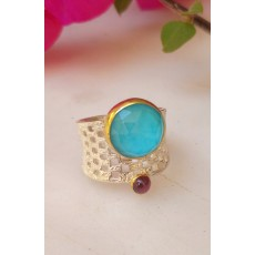 Contemprary Sterling Silver ring with a Turquoise and a Garnet